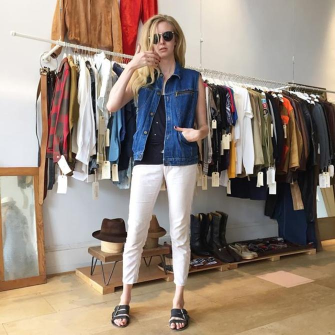 Betsy wears a 80s denim vest with zip pockets  come check out our new arrivals! #vintagestyle #80s #denimvest #meepsdc