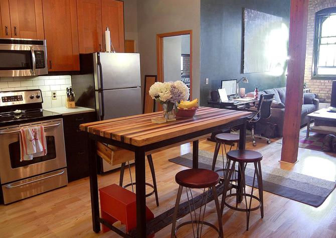 butcher block kitchen island with industrial base and wine rack by