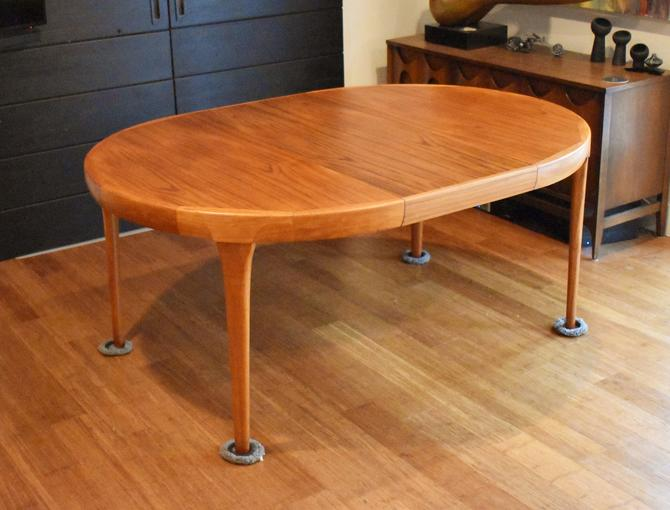 Restored Danish teak round-to-oval expandable dining table by Kofod Larsen for Faarup Mobelfabrik by MidCenturyClever