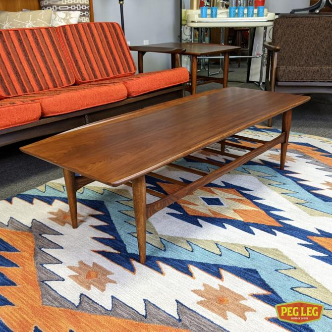 Mid-Century Modern walnut coffee table with curved edges