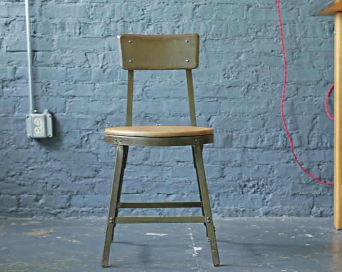 vintage industrial heavy-duty steel chair with wood seat, footrest and tapered legs by jeglova