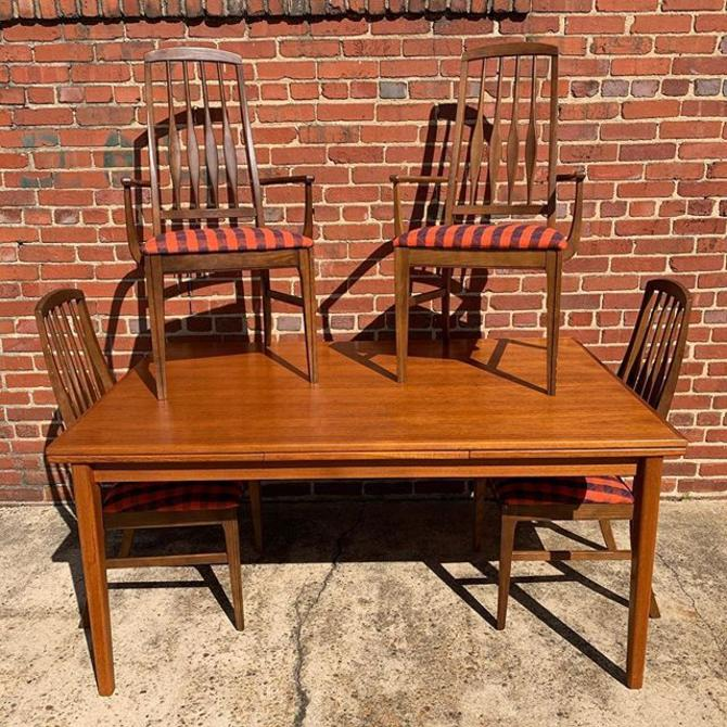 Danish teak extension table with Keller high back dining chairs (6 chairs, 2 with arms)