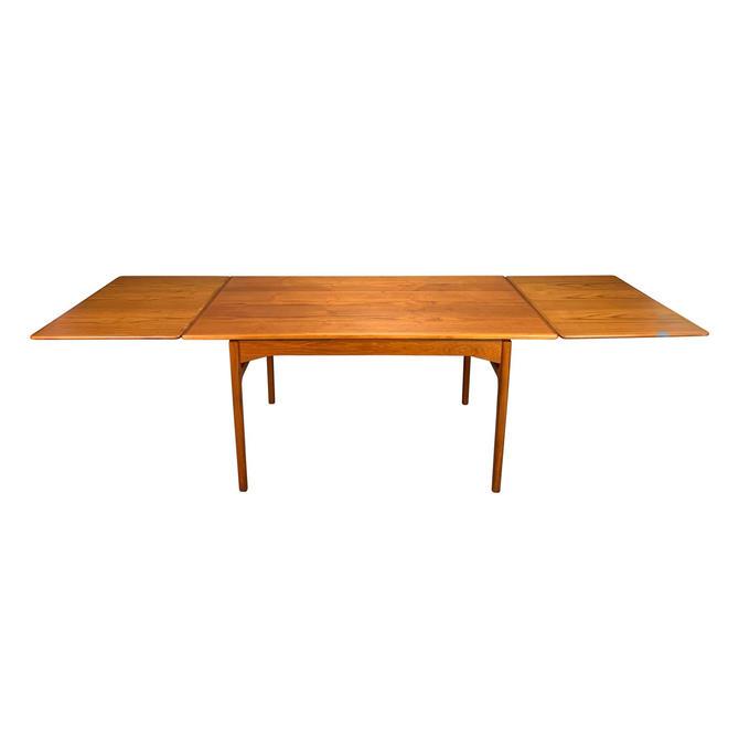 Vintage Danish Mid Century Modern Teak Draw Leaf Dining Table by AymerickModern
