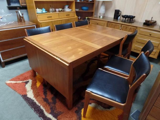 Large Danish Modern teak dining table with drop side leaves