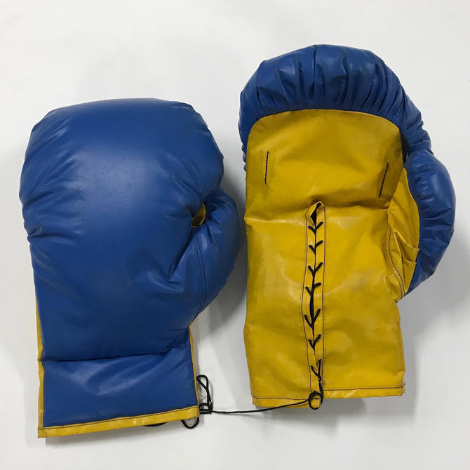 Two pair of giant sized pop art boxing gloves by PeachModern