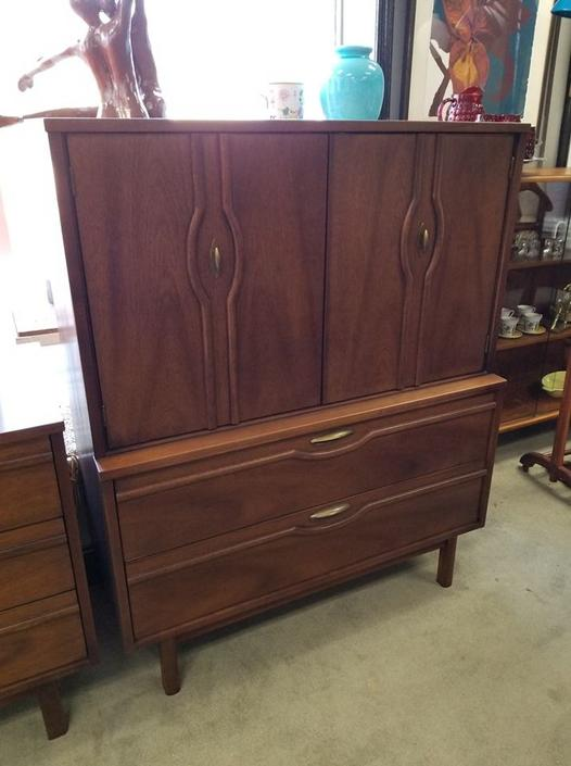 Mid-Century Modern chest on chest with sculpted fronts