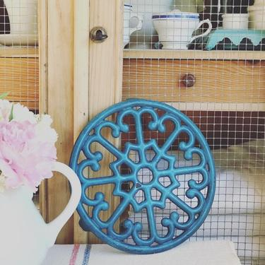 Beautiful bi rage French blue teal cast iron trivet by Grainsacfrenchvintag
