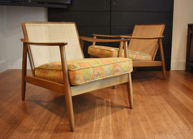 Pair of restored Folke Ohlsson for DUX cane-back lounge chairs, circa 1960s by MidCenturyClever