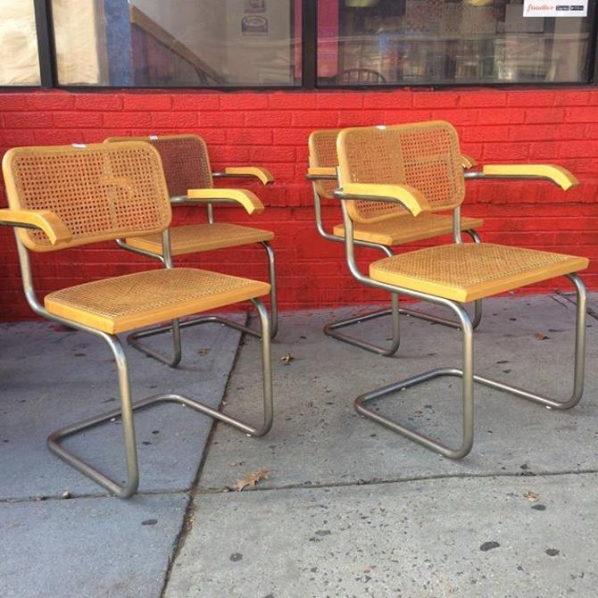 SOLD - Set of four Breuer cane arm chairs.