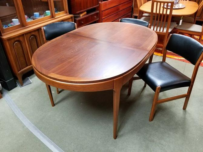 Mid-Century Modern oval walnut dining table from the Rhythm ...