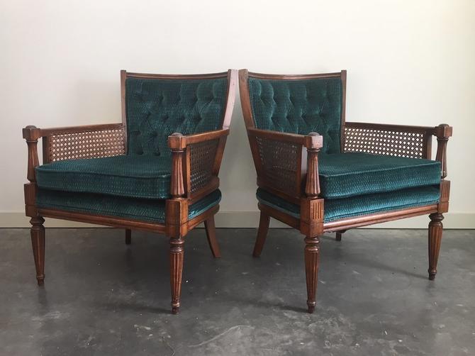 pair of vintage cane armchairs in teal.