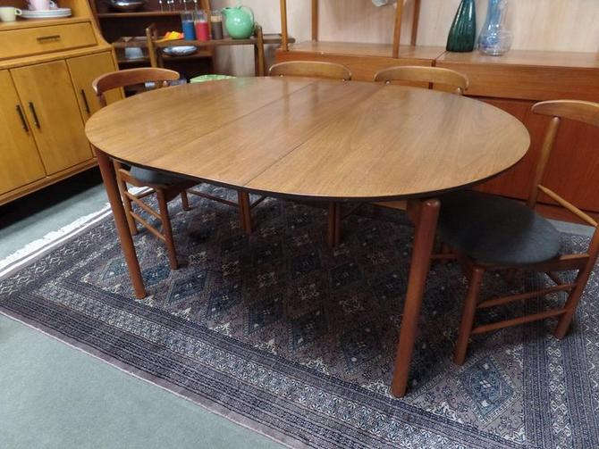 Danish Modern round dining table with one leaf