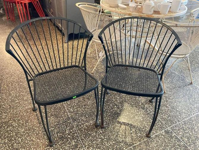 "Black wrought iron chairs, 4 available, 31"" high"