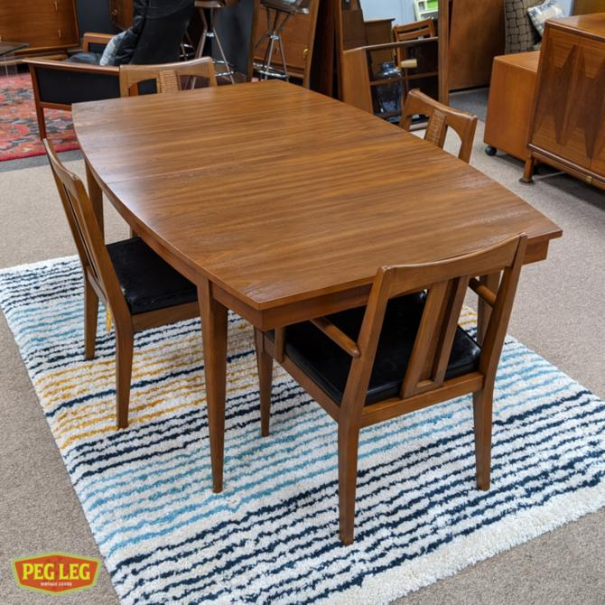 Mid-Century Modern walnut boat-shaped dining table with drop-in extension