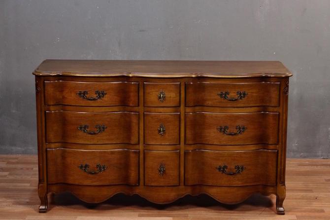 Provincial Serpentine 9-Drawer Dresser