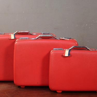 Trio of 1960s American Tourister Ruby Suitcases