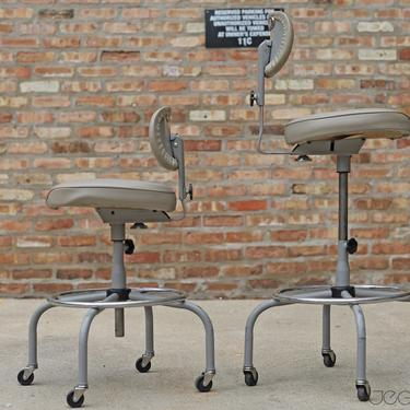 pair of amazingly adjustable desk- or bar-height seating: grey vinyl vintage industrial rolling drafting stools by Cramer, free shipping by jeglova