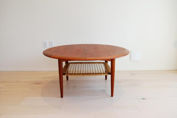 Danish Modern Johannes Andersen Teak Round Coffee Table with Rattan Shelf by CFC Silkeborg by MidCentury55