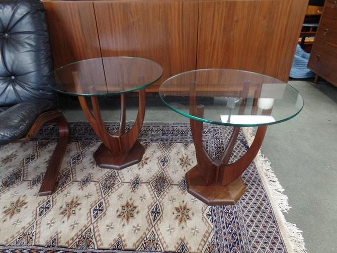 Pair of Mid-Century Modern sculpted walnut side tables
