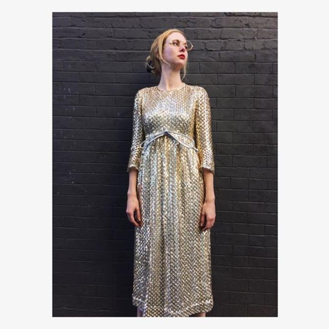 Glam #vintage gold - Betsy wears #AnneFogarty #sequin dress & #octagonal wire frames, both from the 1950s  #LordandTaylor #oldgold #paillettes #partywear #bigbow #holidays