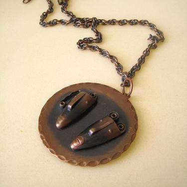 Rebajes copper pendant comedy tragedy on chain by PREVIEWMOD