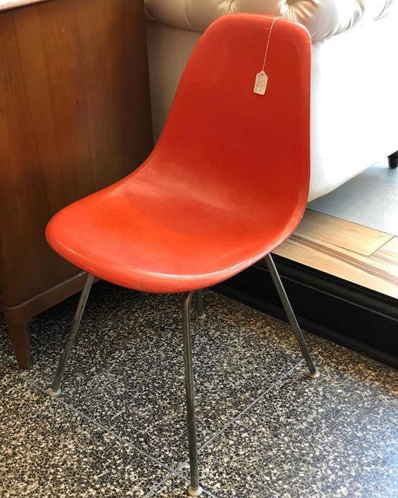 Single Herman Miller orange fiberglass shell chair - $85