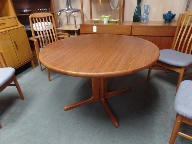 Danish Modern teak round pedestal dining table with two 20\