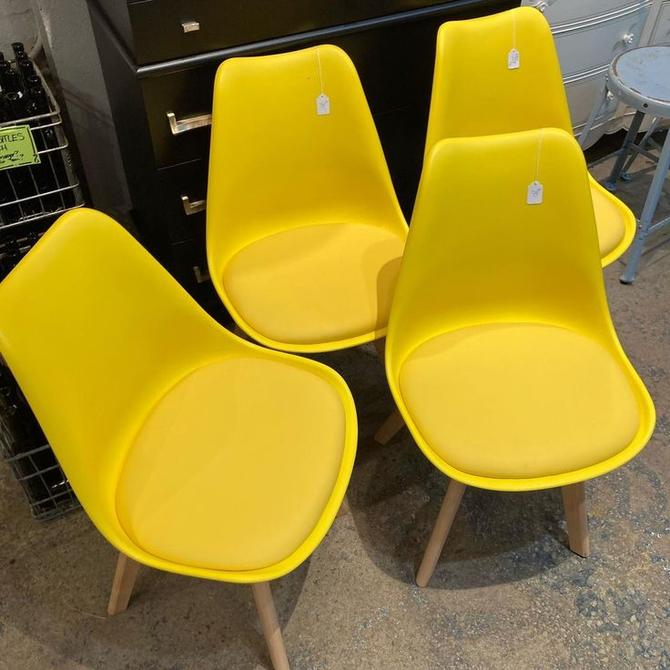 "Really comfy really yellow scoop chairs with padded seat. 4 available 19.5"" x 16"" x 32"" seat height 17"""