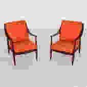 Orange Danish vintage lounge chairs restored
