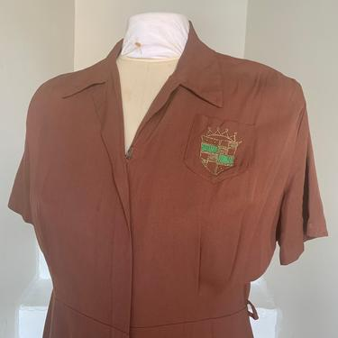 Late 1940s Voluptuous 44 Bust Chocolate Rayon Dress with Crest and Zip Front Vintage by AmalgamatedShop