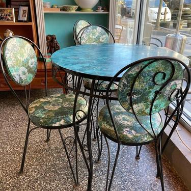 """Laminate top iron table with four iron and vinyl chairs. Table is 30"""" x 29.5"""""""
