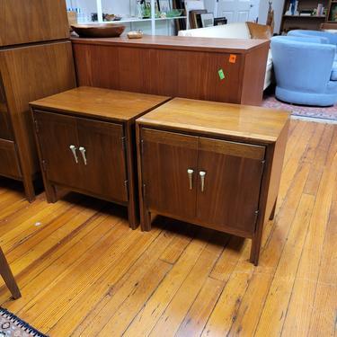 Pair of nightstands in walnut with unusual pulls