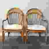 pair of vintage rattan arm chairs.