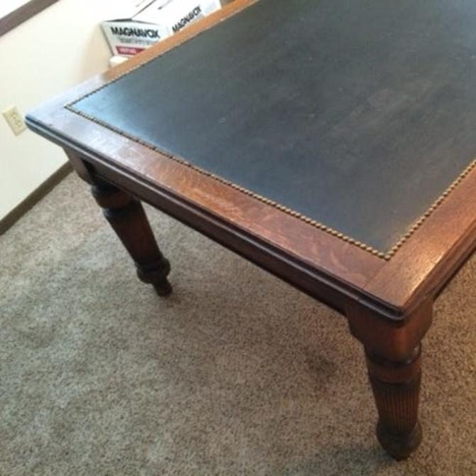 Antique oak and leather conference table