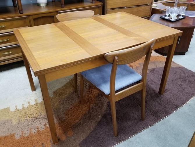 Danish Modern teak draw leaf dining table
