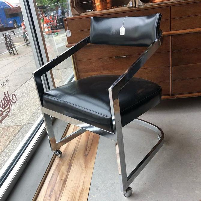 Black vinyl and chrome modern chair (on wheels)! $125