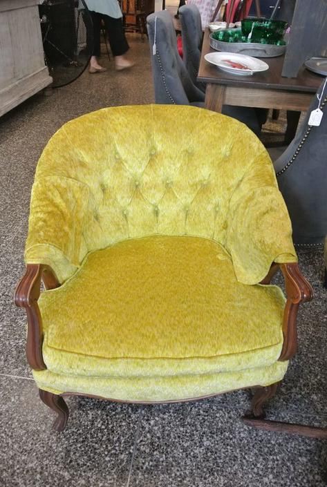 Yellow upholstered chair. $150