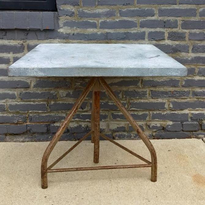 Zinc-top industrial table! It's adjustable, and blends its cool blue-gray metal and its rustic metal base beautifully.