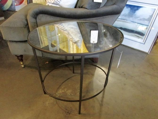 BLACK IRON AND SMOKEY MIRROR OVAL ACCENT TABLE