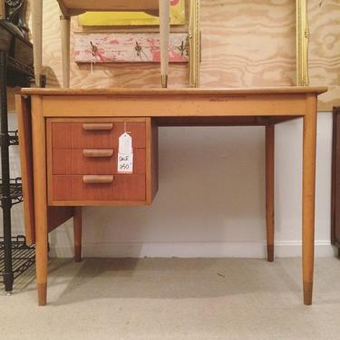 Midcentury modern desk with three drawers and fold out extension