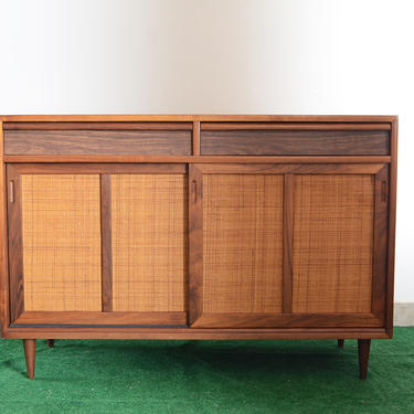 Mid-century Danish style cabinet with rattan panel doors by fingerlickingvintage
