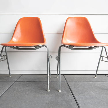 SOLD | Vintage Herman Miller mid century modern orange 1960s Eames DSS shell chairs pair in amazing condition by GoodWilson