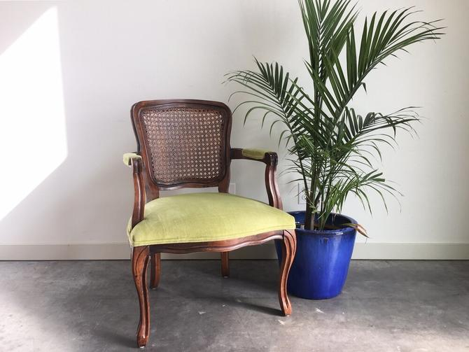 vintage lime green cane back armchair.