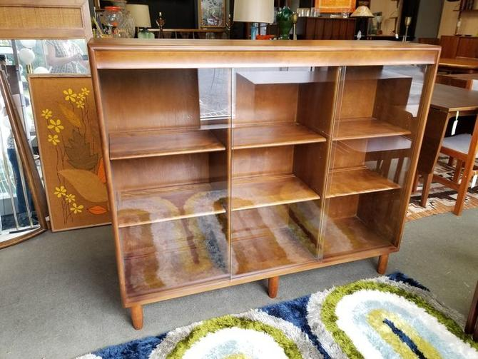 Mid-Century Modern bookcase with sliding glass doors