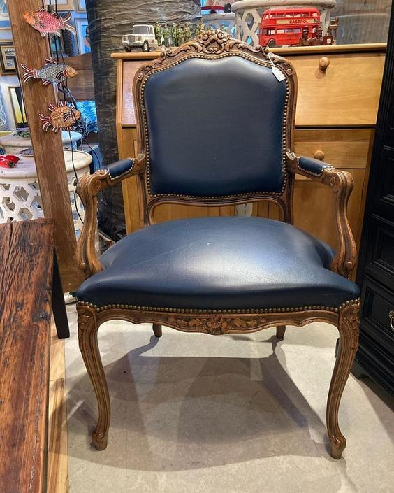 """Carved wood and leather chair. 26"""" wide 22"""" deep 40.5"""" tall"""