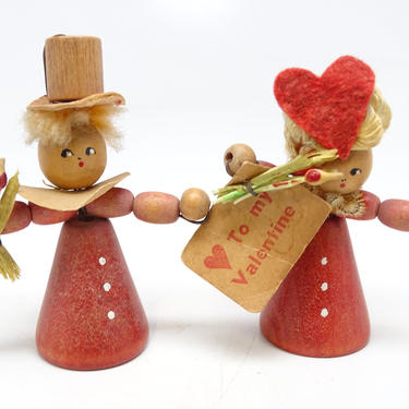 Vintage 1950's Valentine Couple,  Girl Holding Valentine and Boy Holding Flowers by exploremag