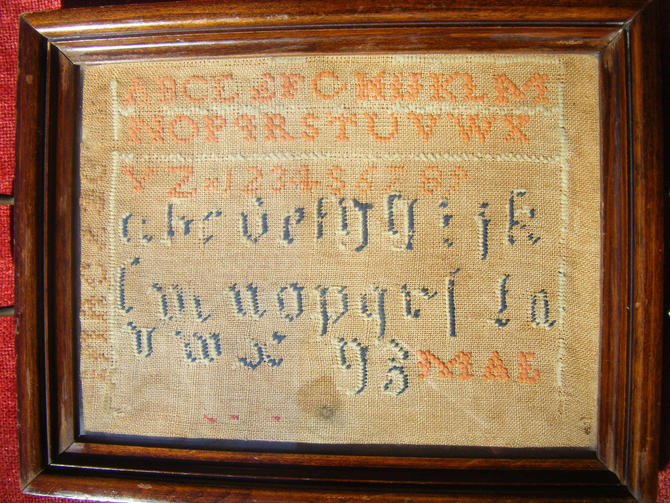 1893 Alphabet Sampler framed by tray, initial M A E by exploremag