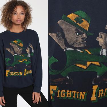 Notre Dame Sweatshirt 80s FIGHTING IRISH Football University Sweatshirt 1980s College Graphic Sweater Vintage Raglan Navy Blue Medium Large by ShopExile