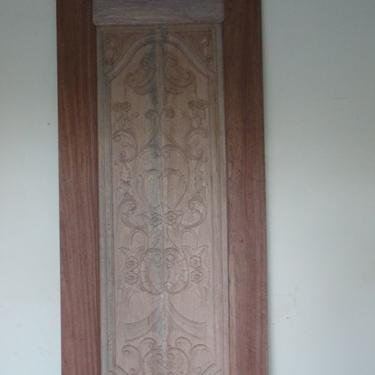Very heavy and beautifully carved door.  One can easily make a table out of it.