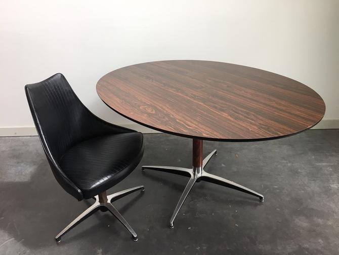 vintage mid century modern oval dining table by Virtue Furniture.